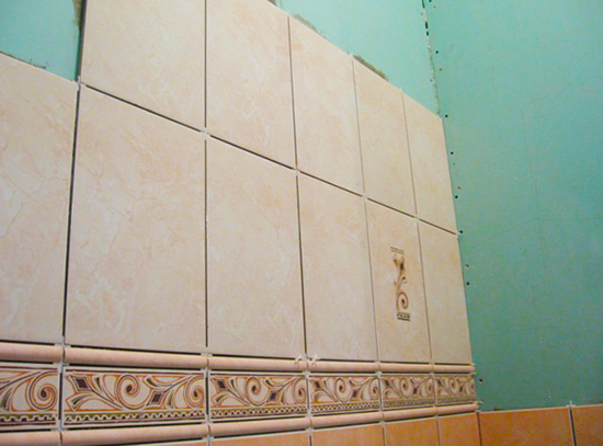 Laying tiles on drywall in the bathroom